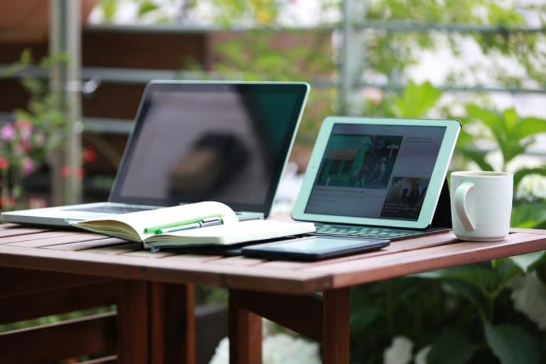 Work where you want. Laptops on table outside.