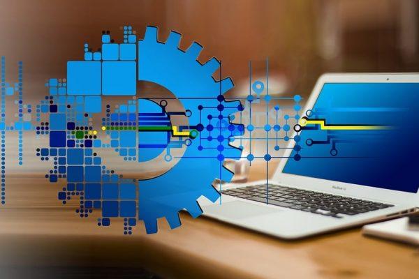 Digital transformation - laptop and cogwheel